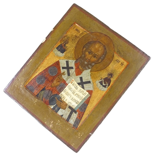 32 - A 19th century Russian painted and gilded icon on wood panel, 27cm x 22cm...
