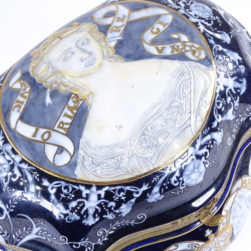 328 - A Continental porcelain box of shaped form, with painted and gilded decoration, width 28cm...