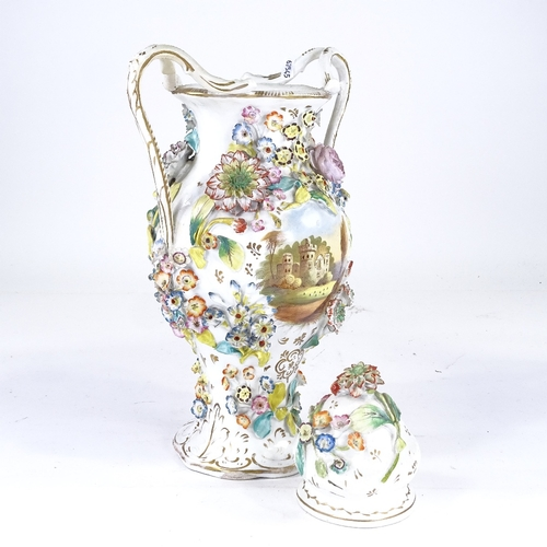 329 - A 19th century Coalbrookdale 2-handled vase and cover, with painted castle scene and encrusted with ...