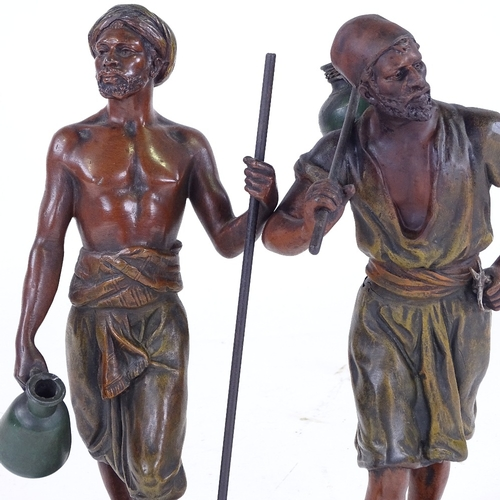 337 - A pair of bronze patinated spelter figures of African men, height 31cm...