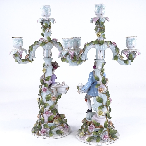 340 - A pair of Continental porcelain 3-branch candelabra, supported by country figures, height 42cm...