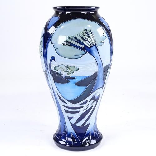 367 - Moorcroft Pottery vase with blue landscape design, 2003, height 32cm...