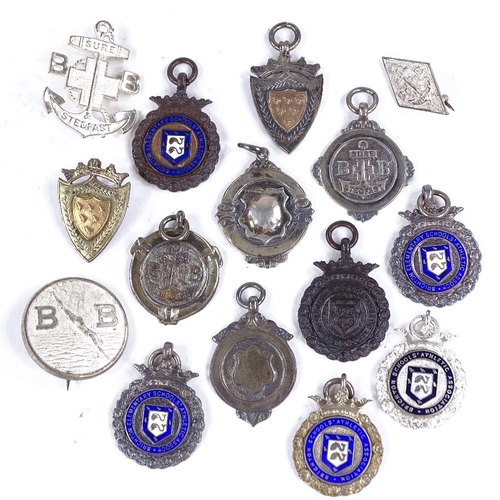 374 - A collection of silver fobs, including some enamel...