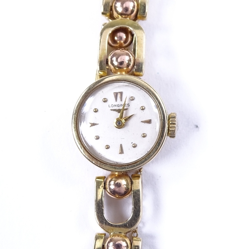 452 - LONGINES - a lady's 14ct gold Eszeha mechanical wristwatch, silvered dial with gilt arrow and dot ho...