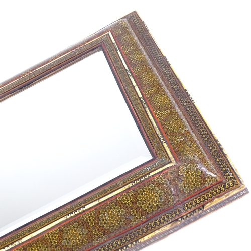 5 - An Islamic micro-mosaic and ivory inlaid cushion-framed mirror, with inset bevelled glass, the decor...