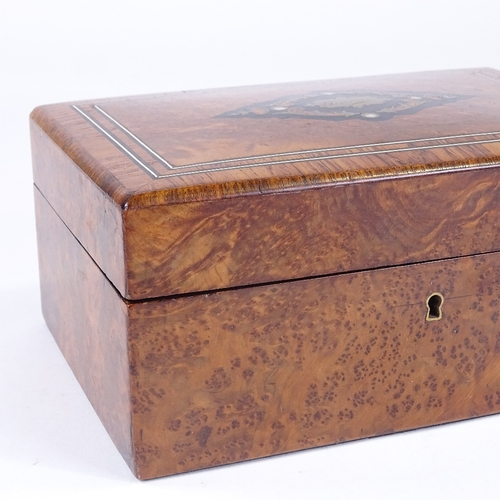 86 - A 19th century French amboyna and tulipwood-banded jewel box, with inlaid brass and ivory marquetry ...