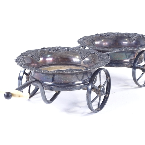 98 - A 19th century Sheffield plate wheeled decanter coaster trolley, with relief cast grapevine surround...