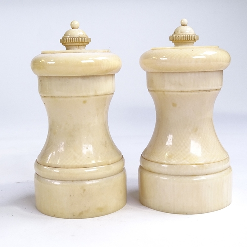 398 - A pair of 19th century ivory pepper grinders, height 10cm...