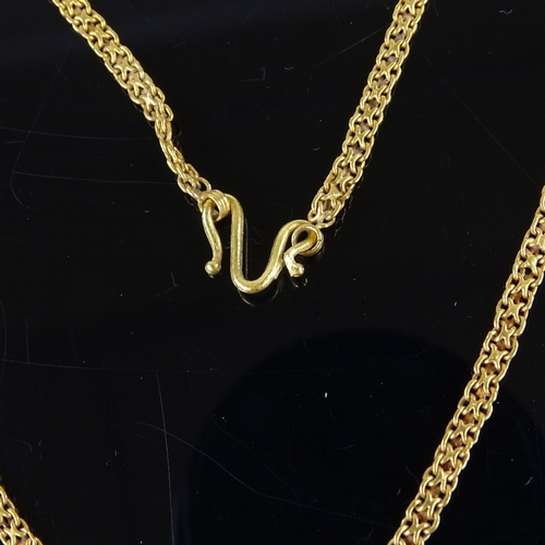 523 - A Middle Eastern unmarked high carat gold fancy link chain necklace, necklace length 39cm, 11.8g...