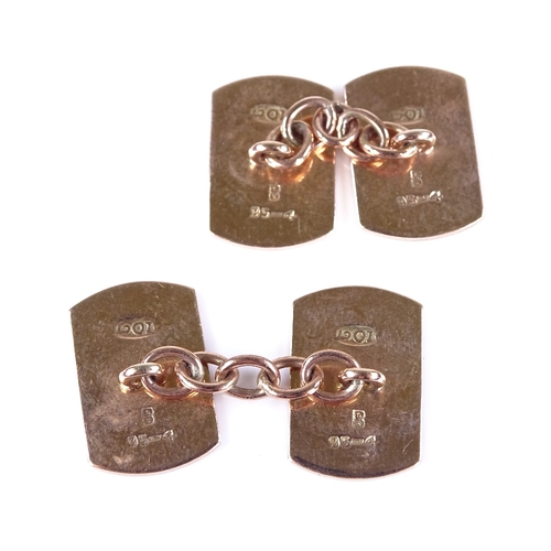 531 - A pair of 10ct rose gold curved rectangular panel cufflinks, engine turned decoration, panel length ...