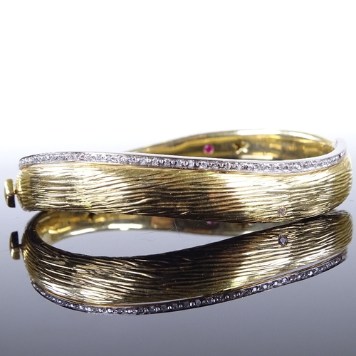 537 - ROBERTO COIN - an Italian designer 2-tone 18ct gold and diamond Elefantino Collection hinged bangle ...