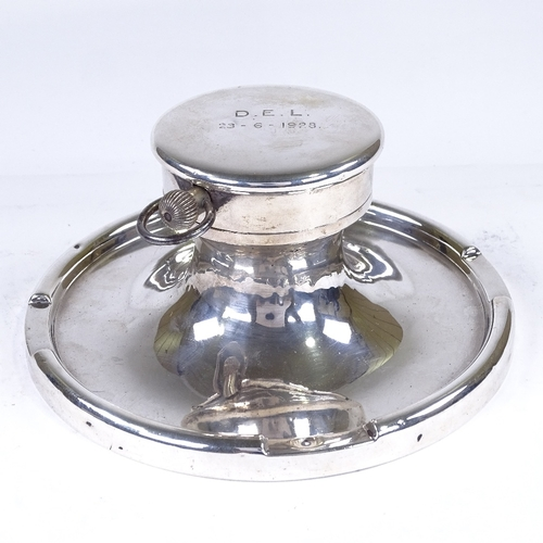 552 - An early 20th century large silver-mounted Capstan inkwell, Goliath pocket watch inset lid with fitt...