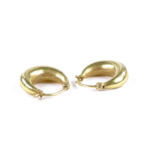 553 - A pair of unmarked gold hoop earrings, earring height 15mm, 2.8g...