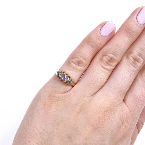 555 - An early 20th century 18ct gold graduated 5-stone sapphire and diamond half hoop ring, palladium-top...