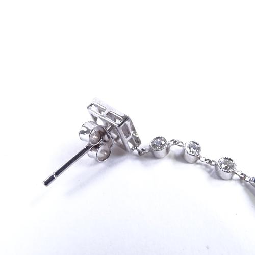 562 - A pair of Art Deco style unmarked white metal jade onyx and diamond drop earrings, jade bi disc susp...