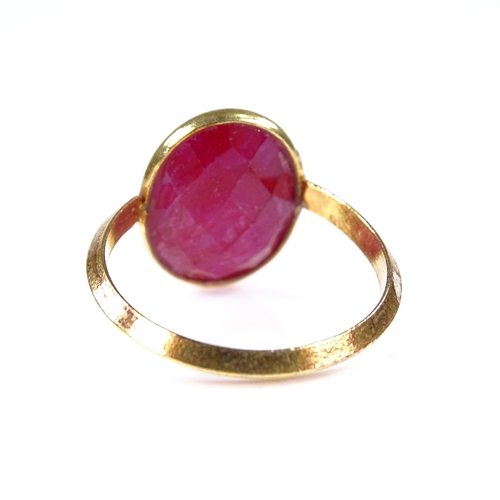 568 - A modern unmarked silver-gilt faceted ruby dress ring, setting height 17.4mm, size M/N, 3.7g...