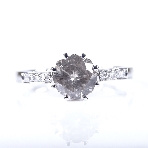 574 - A 14ct white gold 1.01ct solitaire diamond ring, with diamond set shoulders and lozenge design bridg...