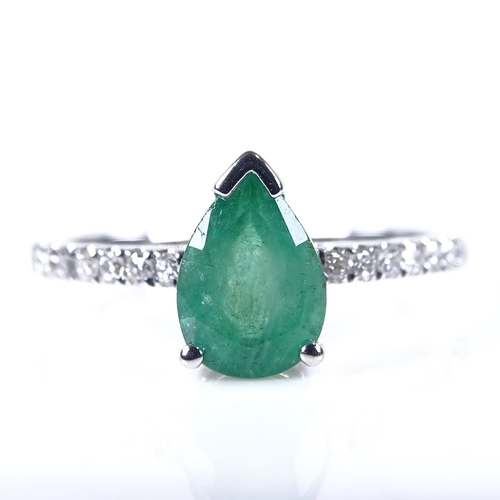 579 - A 14ct white gold solitaire emerald ring, with diamond set shoulders, pear-cut emerald approx 1.12ct...