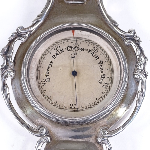 587 - A small Edwardian novelty silver banjo-shaped barometer / thermometer, with pierced foliate surround...