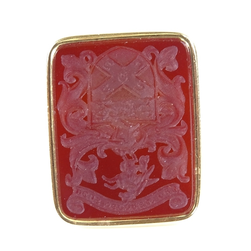 590 - A 19th century 18ct gold intaglio carved carnelian seal fob, armorial crest with unicorn dragon and ...