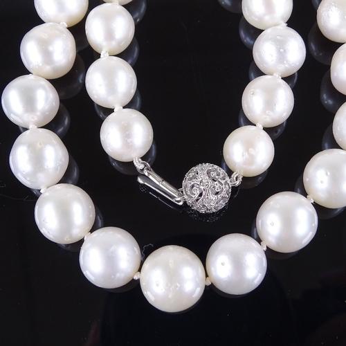 594 - A single strand Princess South Sea pearl necklace, with 14ct white gold diamond set clasp, pearl dia...