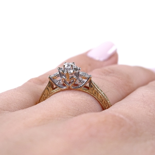 621 - A modern 9ct gold 3-stone diamond dress ring, engraved shoulders with heart-shaped bridge, total dia...