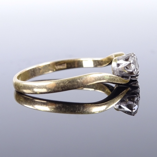 631 - A late 20th century 18ct gold 2-stone diamond cross-over ring, total diamond content approx 0.6ct, s...