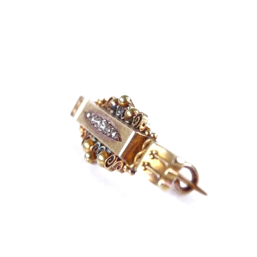 634 - A late 19th century 15ct gold graduated diamond Etruscan bar brooch, hallmarks Birmingham 1897, broo...