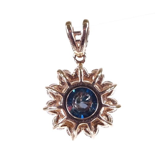 641 - A 14ct rose gold fancy dark blue and colourless diamond cluster pendant, central stone approx 1.1ct,...