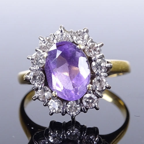 661 - A late 20th century 18ct gold amethyst and diamond cluster ring, total diamond content approx 0.25ct...