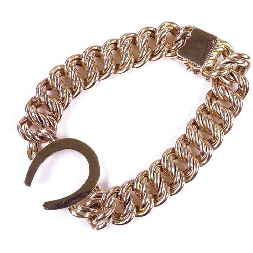 662 - A Victorian unmarked rose gold double curb link horseshoe bracelet, tests as 14ct gold, bracelet len...