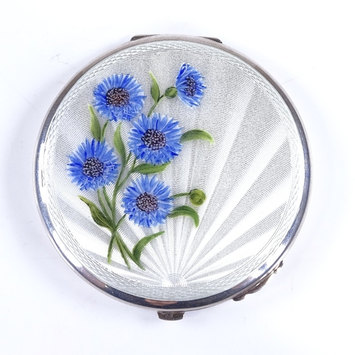 685 - An Elizabeth II silver and enamel circular compact, engine turned sunburst decoration with hand pain...