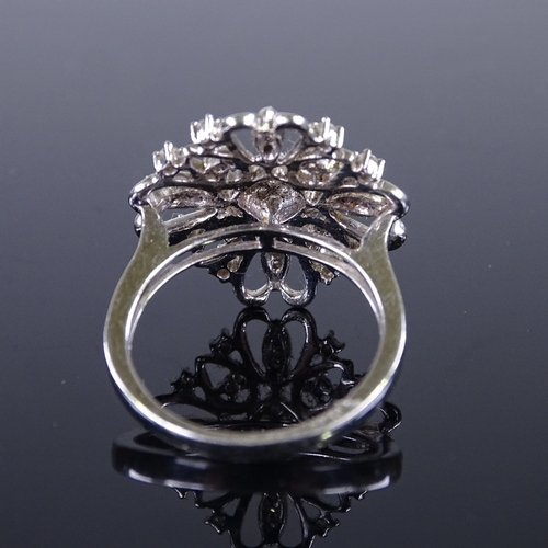 687 - A modern 9ct white gold diamond cluster cocktail ring, setting height 20.1mm, size N, 4.8g...