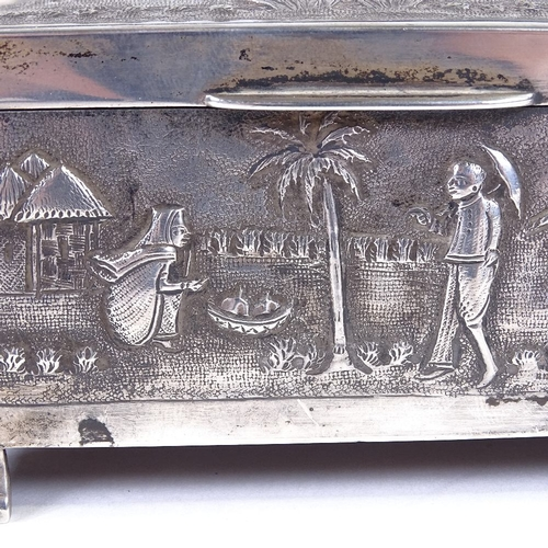 692 - An early 20th century Indian sterling silver cigarette box and matching hand brush, relief embossed ...