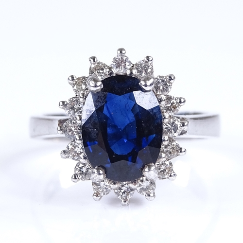 694 - A modern 18ct white gold sapphire and diamond cluster ring, total diamond content approx 0.35ct, set...
