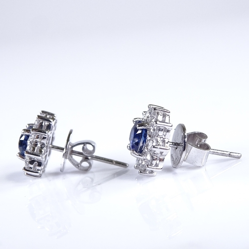 695 - A modern pair of unmarked white metal sapphire and diamond cluster earrings, platinum butterflies, t...
