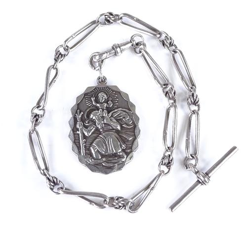 699 - A heavy Art Deco silver Saint Christopher pendant, on early 20th century silver fancy link Albert wi...