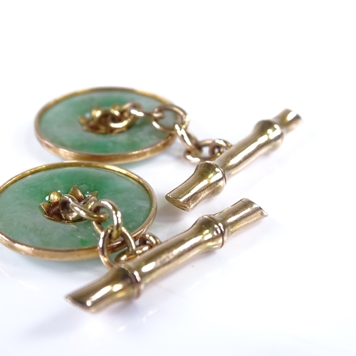 710 - A pair of Chinese 14ct gold jade disc character mark panel cufflinks, panel diameter 16.4mm, 5g...