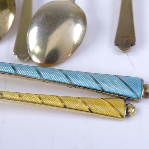 713 - EGON LAURIDSEN - a group of Danish vermeil sterling silver and harlequin enamel flatware, comprising...