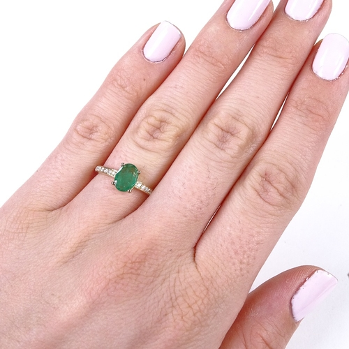 717 - A 14ct gold solitaire emerald ring, with diamond set shoulders, oval-cut emerald approx 0.71ct, tota...