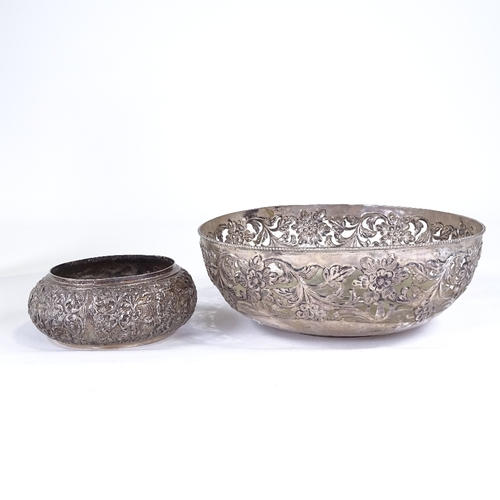 749 - A large white metal fruit bowl, marked silver (16.1oz), and an Eastern white metal bowl marked 90 (1...