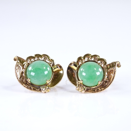 753 - A pair of Chinese unmarked gold jade earrings, engraved foliate decoration with screw fittings, earr...