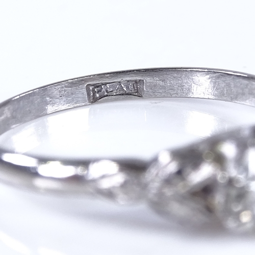 755 - An early 20th century platinum 0.35ct solitaire diamond ring, engraved leaf shoulders, diamond measu...