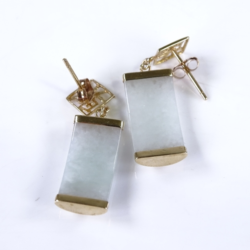 758 - A pair of Chinese unmarked gold and jade curved panel drop earrings, overall earring height 30.6mm, ...