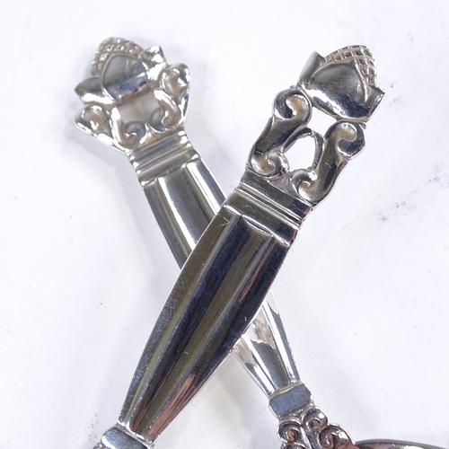 767 - GEORG JENSEN - a Danish stylised sterling silver Acorn pattern (Konge) preserve spoon and pastry sli...