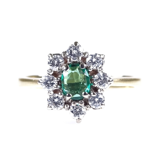 775 - A late 20th century 18ct gold emerald and diamond cluster dress ring, setting height 10.4mm, size J/...