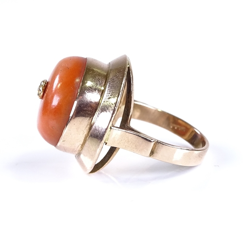 778 - A late 20th century 9ct gold coral dress ring, setting height 20.9mm, size L/M, 11.1g...