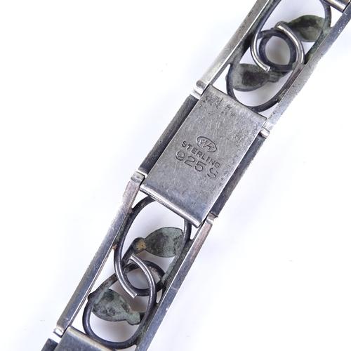 783 - ERNST WILLY KNUDSEN - a Vintage Danish stylised sterling silver floral panel bracelet, bracelet leng...