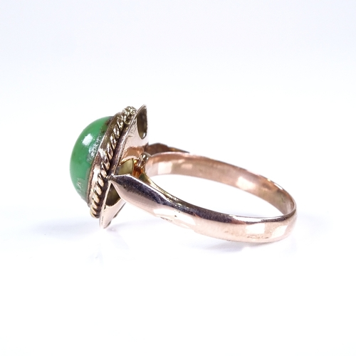 809 - An 18ct rose gold cabochon green stone dress ring, setting height 16.5mm, size P, 3.5g...