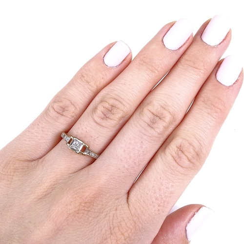 812 - A modern 9ct gold Princess and round-cut diamond dress ring, setting height 5.1mm, size M, 1.8g...